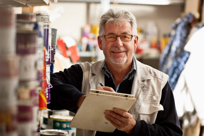 Older caucasian male with clipboard indoors